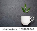 detox tea concept  white cup on ... | Shutterstock . vector #1031078368