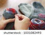 Darning Socks  Repairing Holes...
