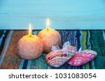 round candles are lit  two... | Shutterstock . vector #1031083054