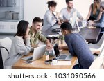 happy team of businesspeople... | Shutterstock . vector #1031090566