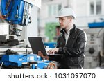 young engineer with laptop in... | Shutterstock . vector #1031097070
