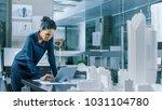 female architectural designer... | Shutterstock . vector #1031104780
