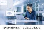 beautiful female data analyst... | Shutterstock . vector #1031105278