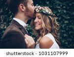amazing smiling wedding couple. ... | Shutterstock . vector #1031107999