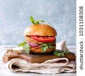 homemade burger in classic bun...   Shutterstock . vector #1031108308