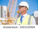 engineer man in helmet and... | Shutterstock . vector #1031110504