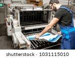 typographer checking printing... | Shutterstock . vector #1031115010