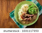 bangers and mash. baked sausage ... | Shutterstock . vector #1031117353