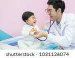 Small photo of Pediatrician examines seven months baby girl, Doctor using stethoscope to listen to little girl checking heart beat,Lovely baby being checked and examine by a pediatric doctor using a stethoscope