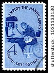 Small photo of London, UK, February 19 2018 - Vintage 1960 United States of America cancelled postage stamp showing Employ the Handicapped