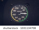 Small photo of Vintage airspeed gauge on a biplane while in flight