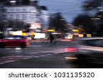 a cyclist drives at twilight... | Shutterstock . vector #1031135320