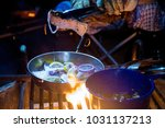 cooking over campfire close up... | Shutterstock . vector #1031137213