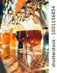 the beer taps in a pub. nobody. ... | Shutterstock . vector #1031156854