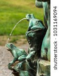 Small photo of Frog splashing water on fountain in Petrin park, Prague, Czech Republic, water shortage scarcity concept