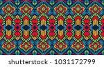ikat geometric folklore... | Shutterstock .eps vector #1031172799