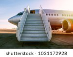 passenger airplane with a... | Shutterstock . vector #1031172928