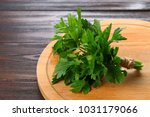 fresh green parsley on the... | Shutterstock . vector #1031179066