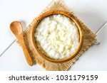 rice milk porridge with nuts... | Shutterstock . vector #1031179159