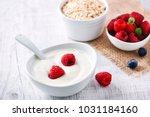 fresh white yoghurt with raw... | Shutterstock . vector #1031184160