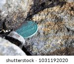 oxidized penny trapped between... | Shutterstock . vector #1031192020