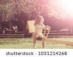 Small photo of Girl sit on seesaw on sunny day. Child have fun on playground. Kid on teeter totter outdoor. Balance, equilibrium, harmony. Childhood, activity, lifestyle.