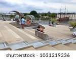 Small photo of AMSTERDAM, NETHERLANDS - JULY 8, 2017: People visit the roof terrace of Nemo Science Museum in Amsterdam, Netherlands. Nemo has over 500,000 annual visitors.