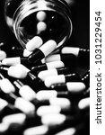pills in capsules | Shutterstock . vector #1031229454