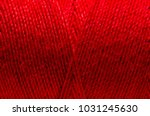 red thread wound on a spool... | Shutterstock . vector #1031245630
