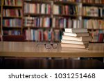 books and eyeglasses on wooden... | Shutterstock . vector #1031251468
