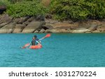 couple canoeing or kayaking at... | Shutterstock . vector #1031270224