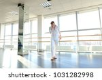 dancer in white suit making... | Shutterstock . vector #1031282998