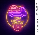 tow truck neon sign  bright... | Shutterstock .eps vector #1031302720