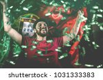 portuguese fan celebrating | Shutterstock . vector #1031333383
