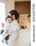 men who take childcare | Shutterstock . vector #1031337250