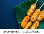 fried banana on banana leaf... | Shutterstock . vector #1031340550
