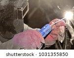worker welding by arc welding... | Shutterstock . vector #1031355850