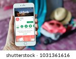 Small photo of Penang, Malaysia - July 12, 2017: Female hand holding smartphone with Airbnb application. Airbnb is an online marketplace and hospitality service, enabling people to lease or rent short-term lodging