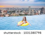 children swimming in roof top... | Shutterstock . vector #1031380798