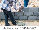 bricklayer working with bricks... | Shutterstock . vector #1031448499