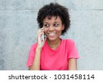 brazilian woman in bright red... | Shutterstock . vector #1031458114