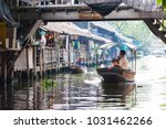 Small photo of Bangkok, Thailand - Feb 11, 2018: Tourists enjoy traveling by tourist long-tail boat on Lad Mayom canal.