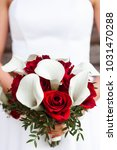 the bride holds a wedding... | Shutterstock . vector #1031470288