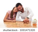 beautiful couple saving money...   Shutterstock . vector #1031471320
