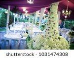 white wonderful wedding cake on ... | Shutterstock . vector #1031474308