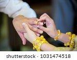 wedding rings.she put the... | Shutterstock . vector #1031474518