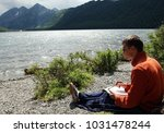 young guy draws sitting on... | Shutterstock . vector #1031478244