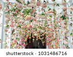 artificial flowers hanging from ... | Shutterstock . vector #1031486716