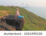 A Bald Man Sits On A Cliff Of ...