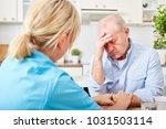 nurse comforts senior man with... | Shutterstock . vector #1031503114